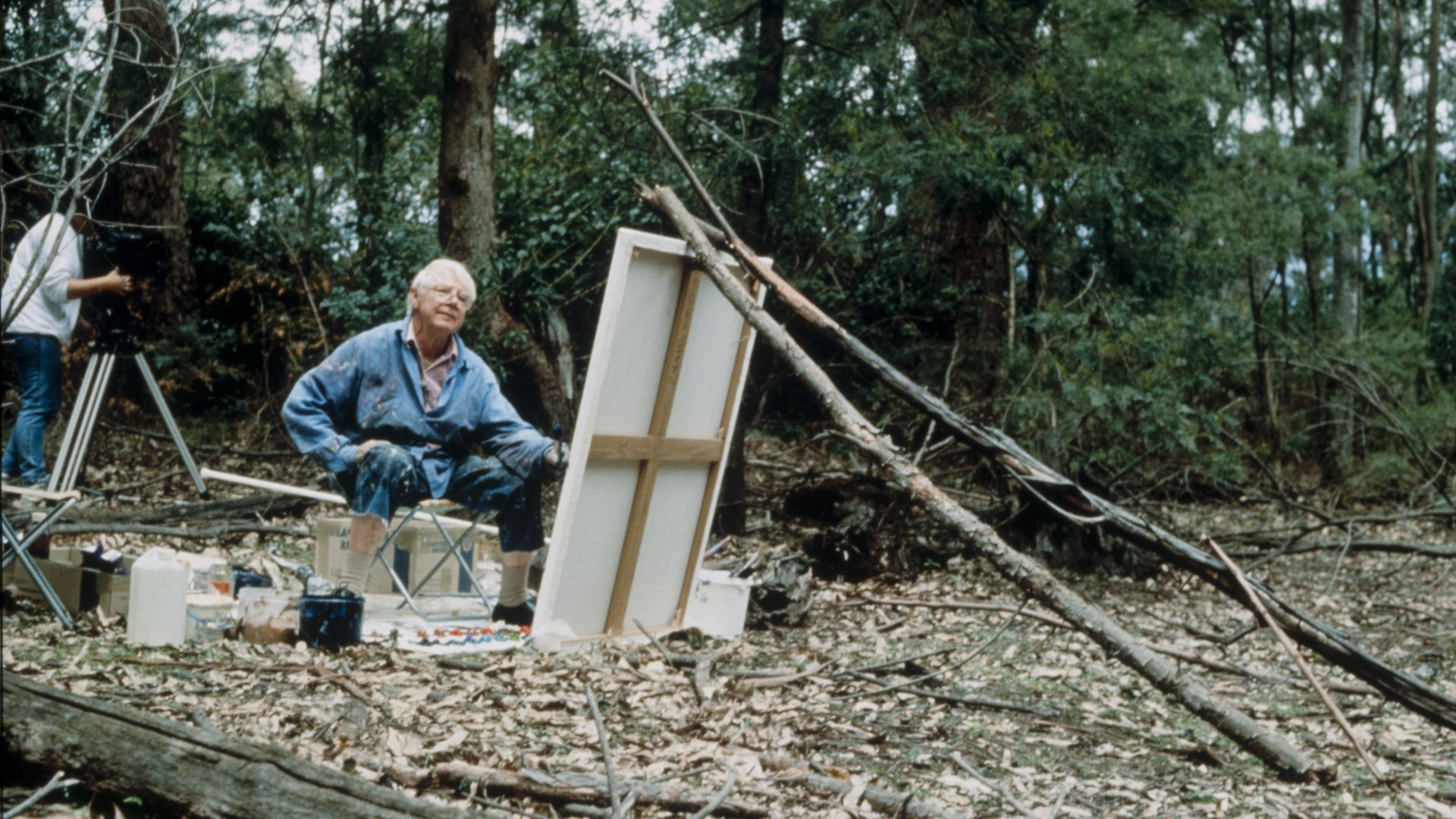 Arthur Boyd painting in on a large canvas in the landscape