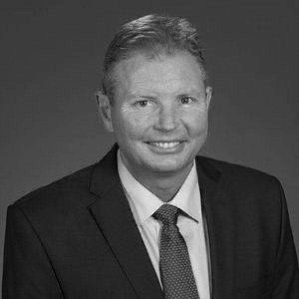 Black and white portrait of Craig Laurey