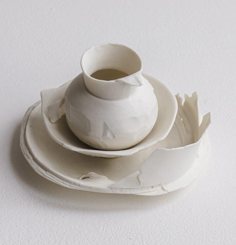 A sculptural ceramic artwork depicting abstract bowl figures